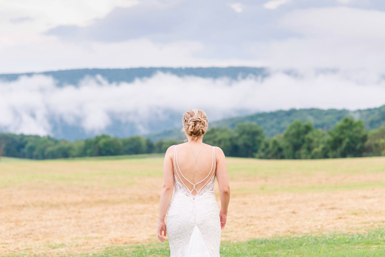 Bride walking toward the mountains