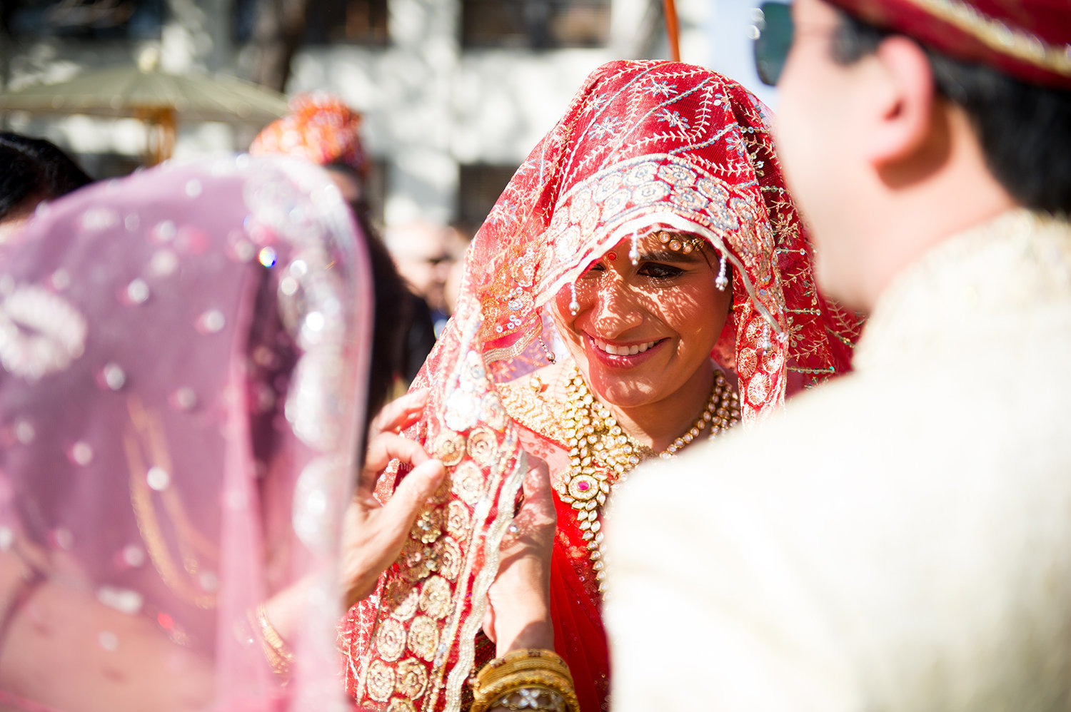 Hindu bride hidden under her veil during the Baraat