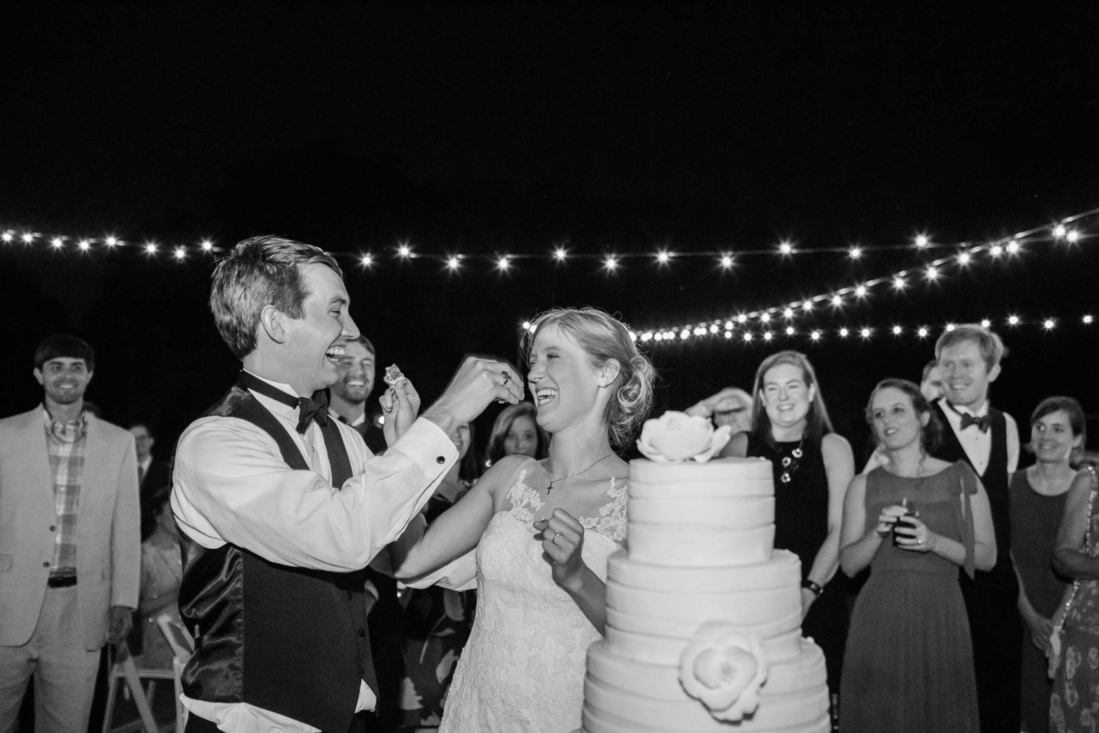 Bride and groom cut the cake, Oakland Plantation, Mt Pleasant, South Carolina