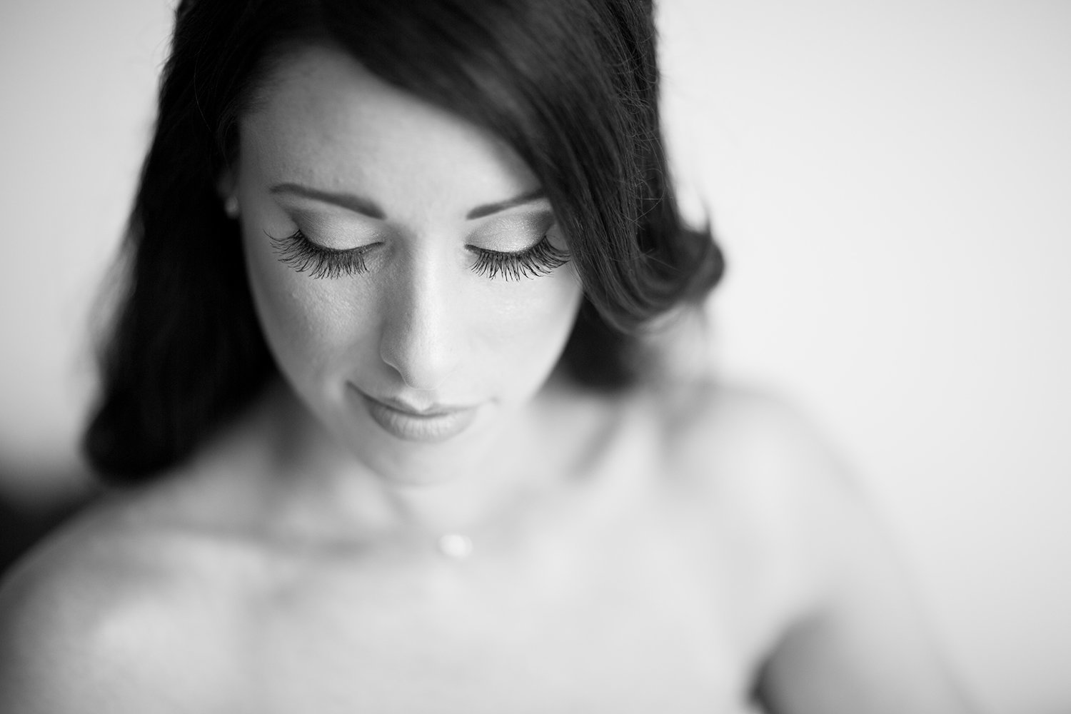 High key high contrast black and white portrait of a beautiful bride