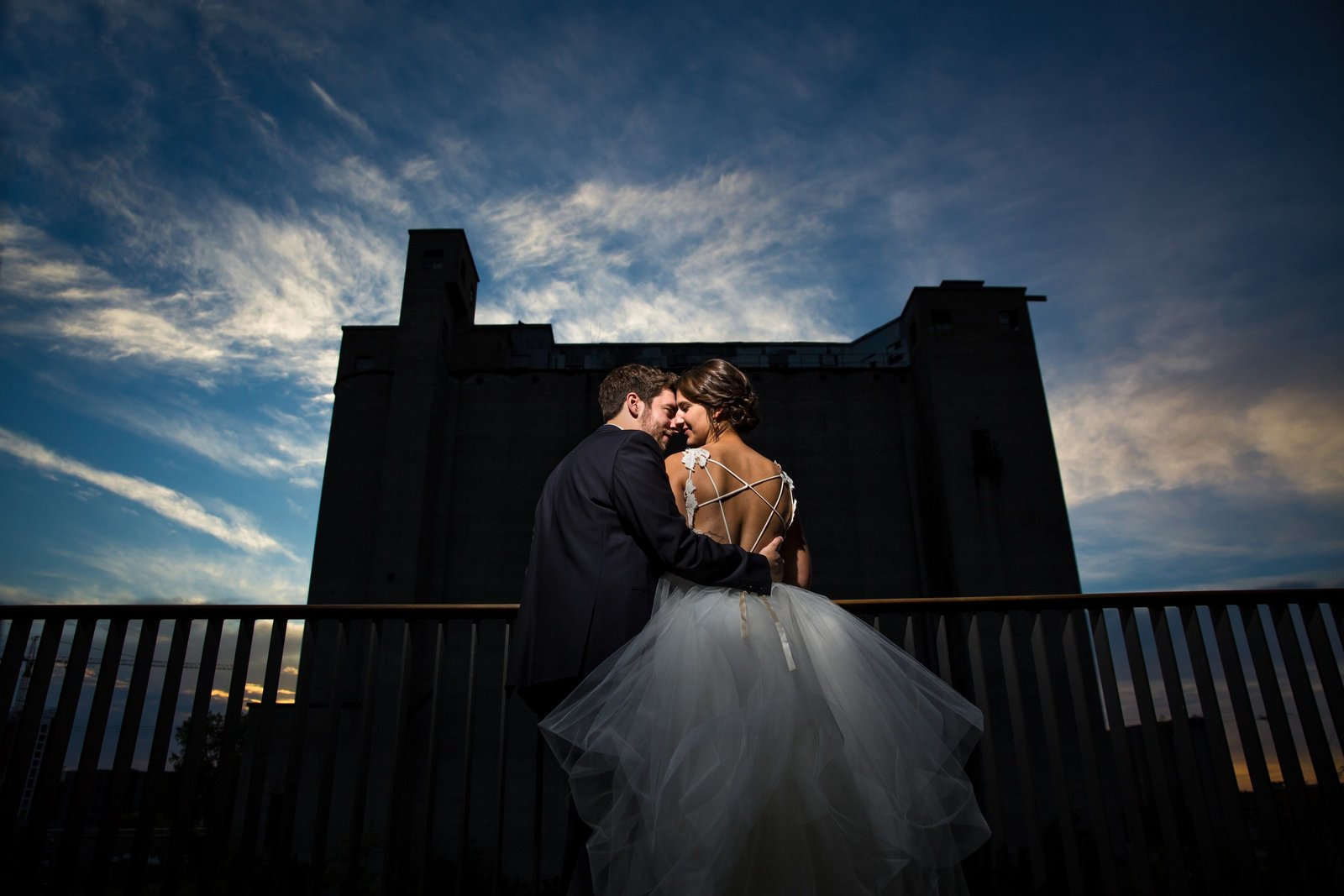 bride and groom having a moment during sunset at Surly brewery Minneapolis