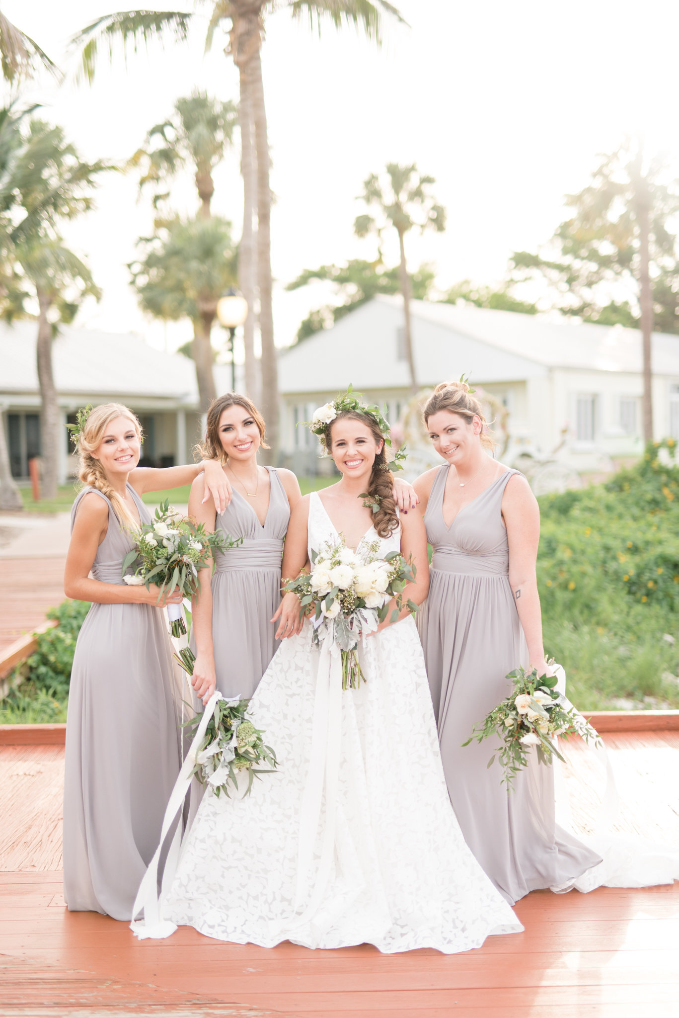 Tampa Bride and bridesmaids smile at camera.