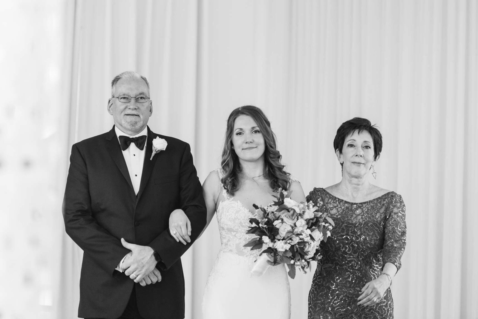 Bride with her parents in black and white at  Allegria Hotel