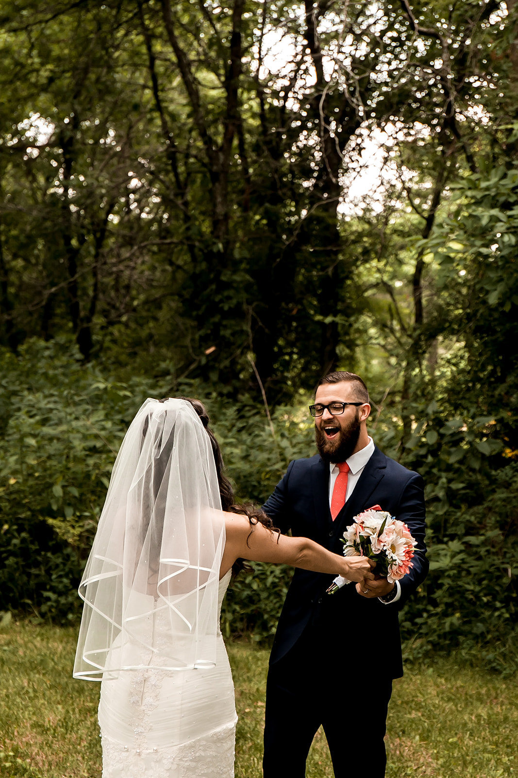 Des Moines Iowa wedding couple first look.