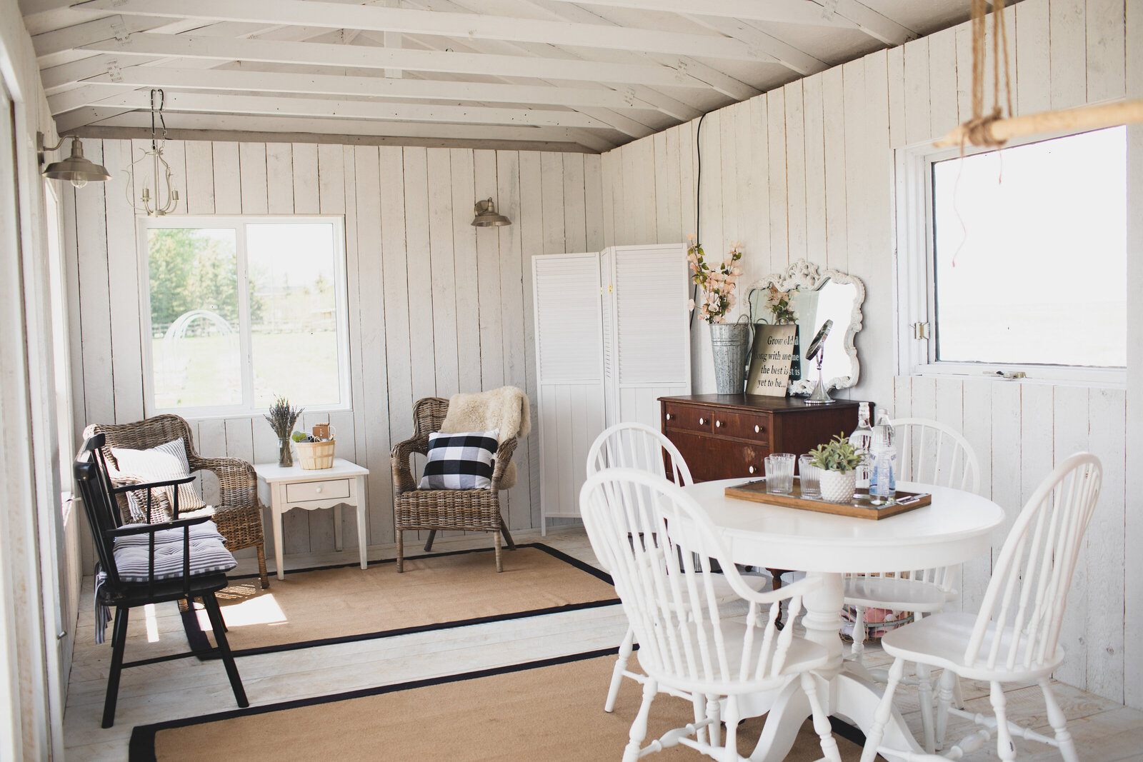 white cottage with white tables and chairs - wicker chairs