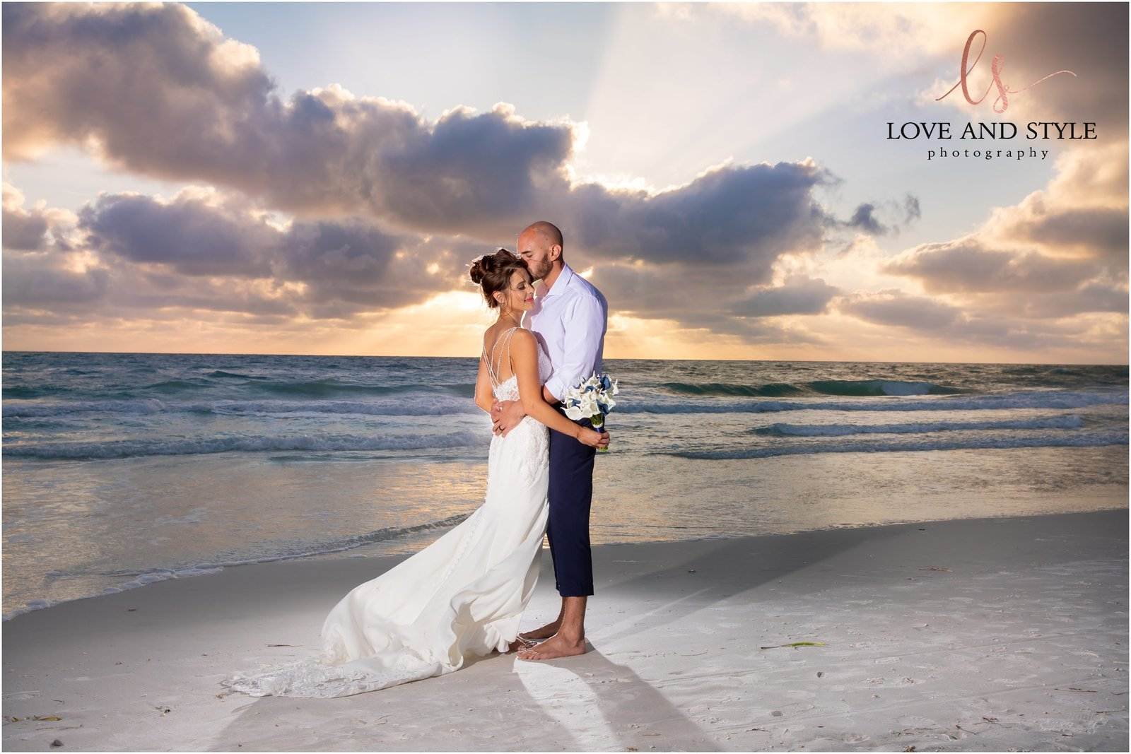 Bride and Groom walking on Bradenton Beach at sunset  in front of The Beach House Restaurant