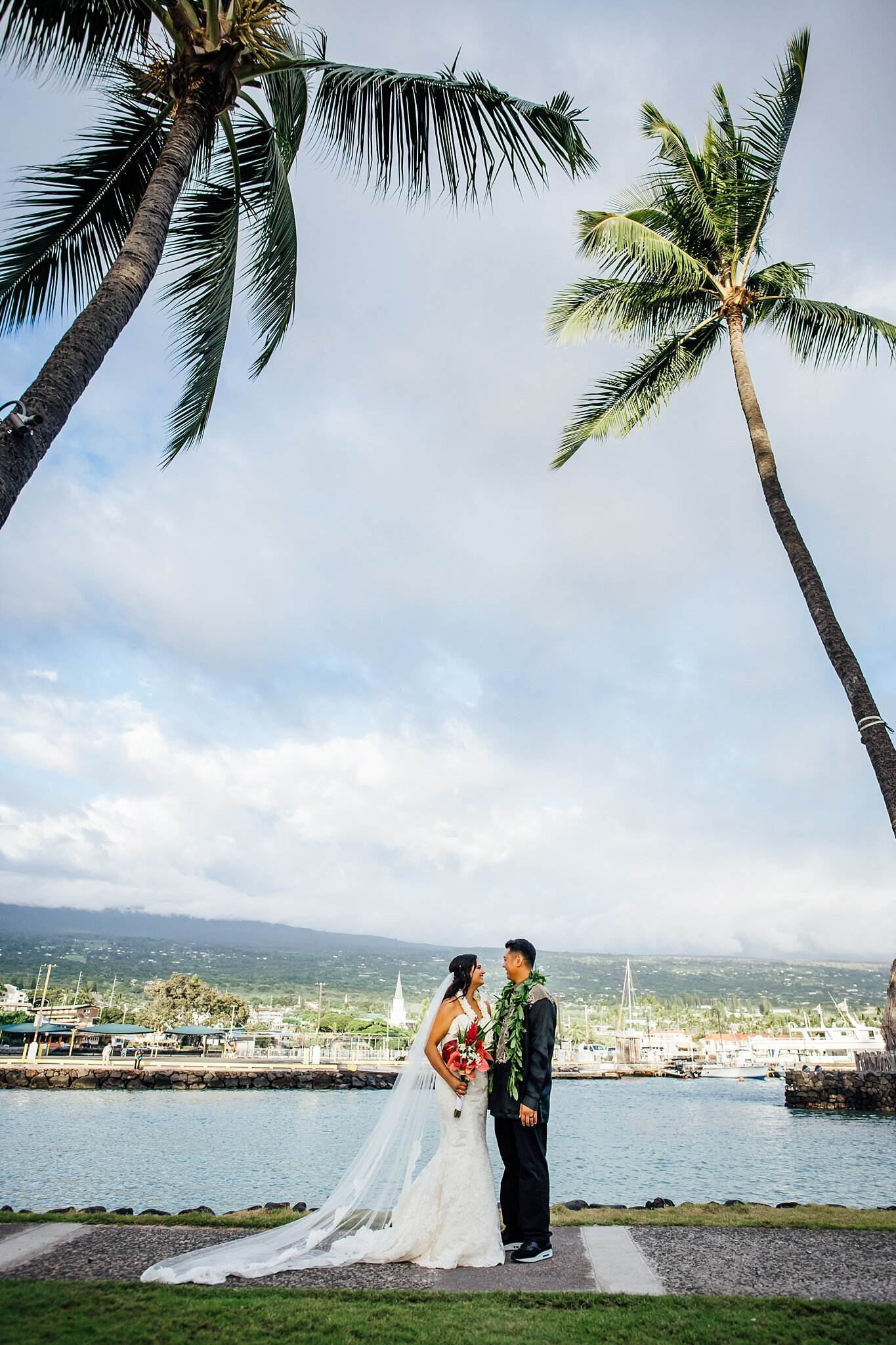 kona pier on background of this wedding