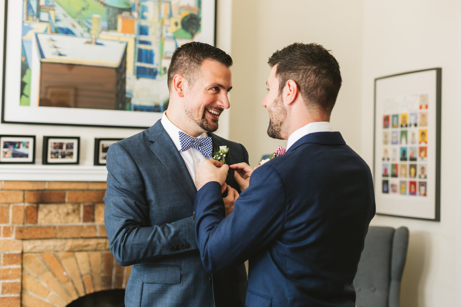 same sex couple tying each other's boutonnieres at their san francisco home
