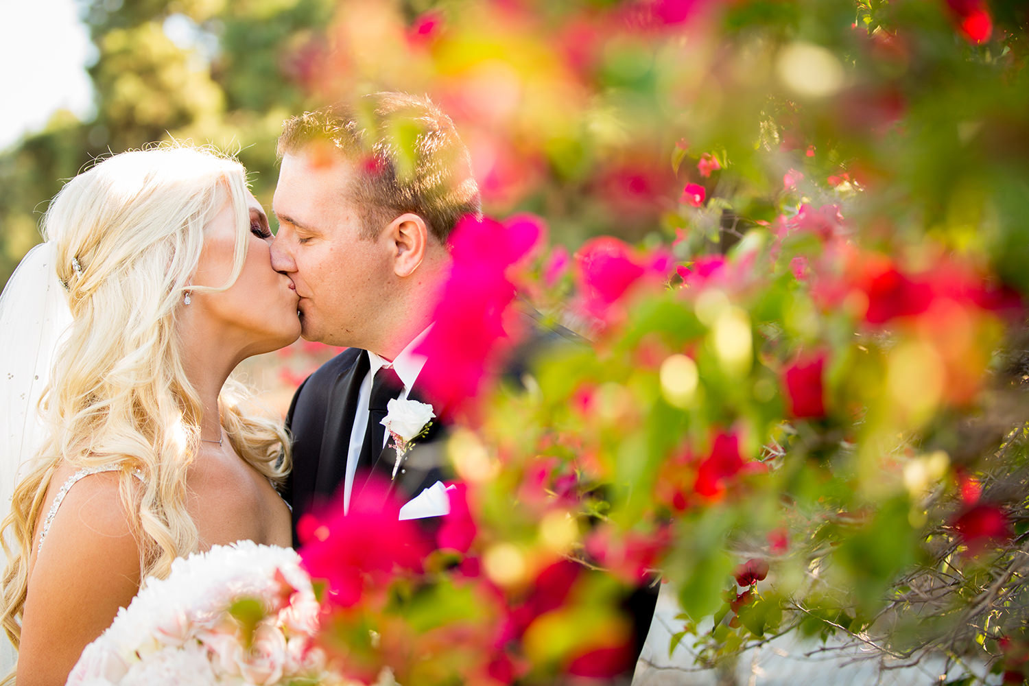 bride and groom kissing with flowers romantic
