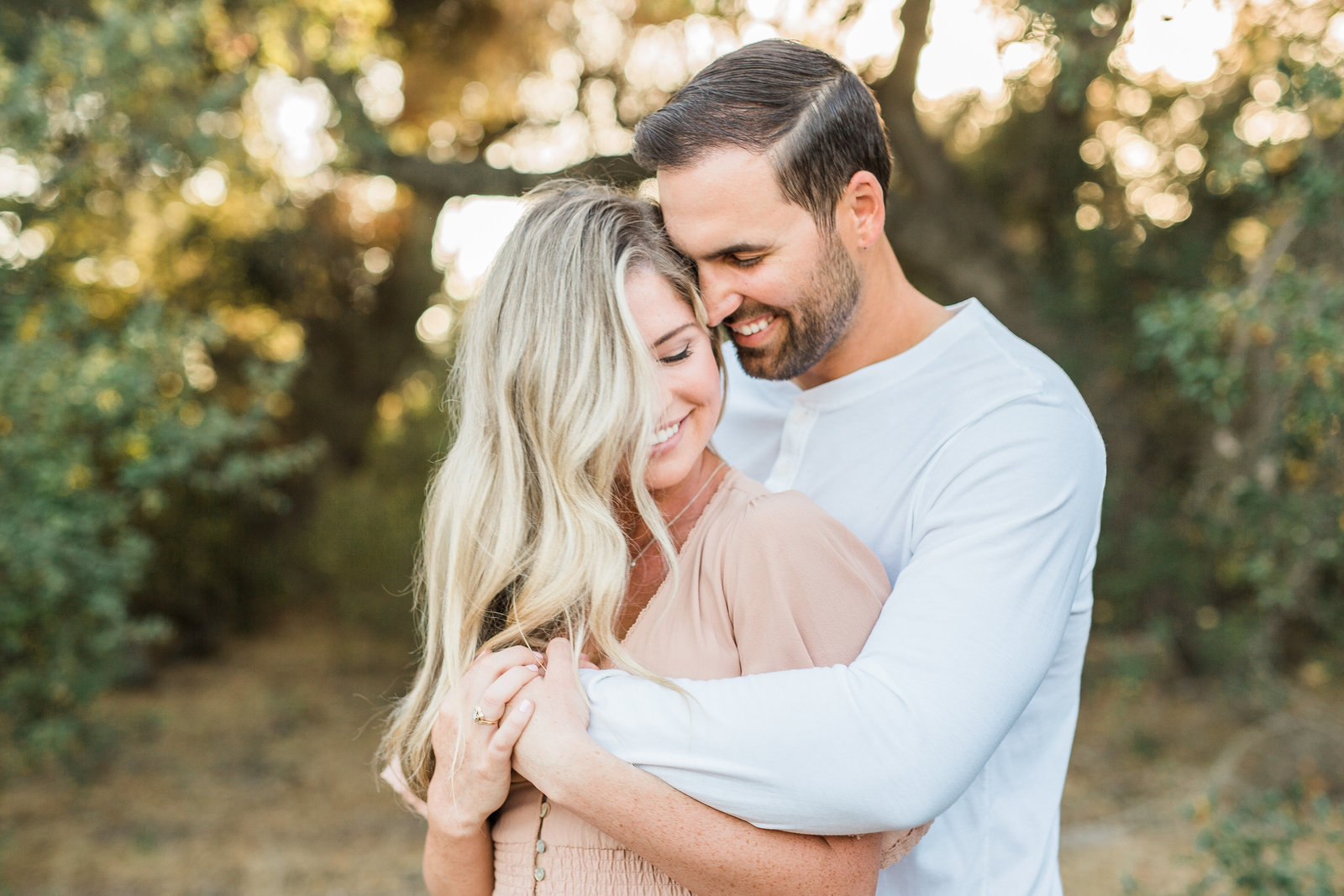 couple at park for engagement photos in Orange County