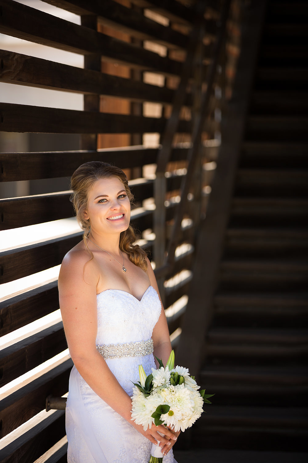 bride smiling with stairs at artin johnson house
