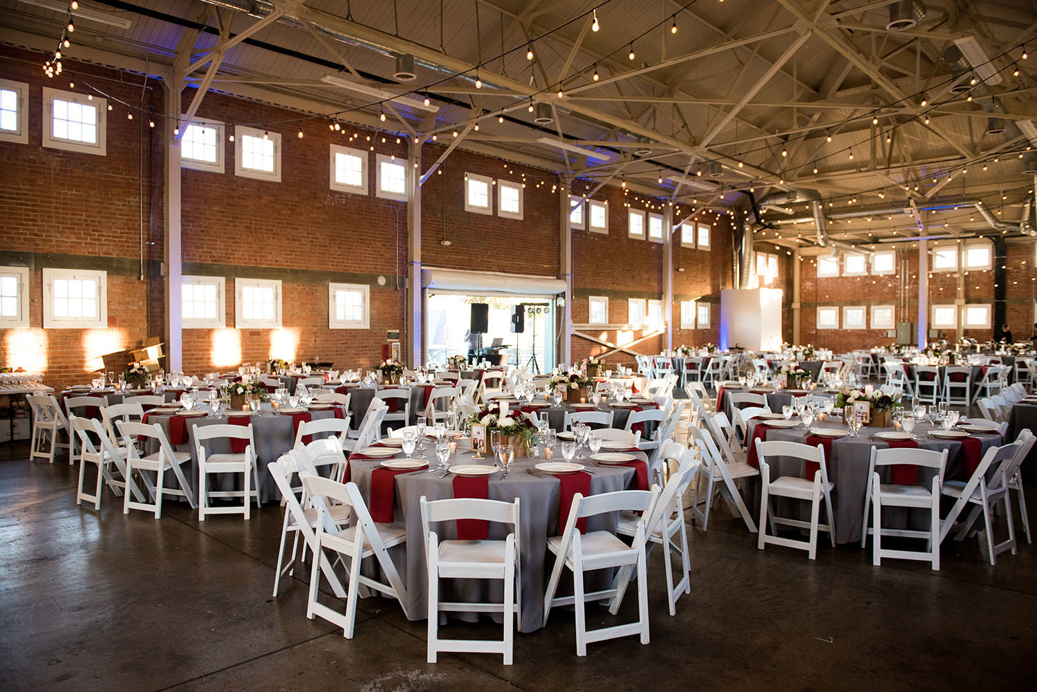 beautiful photo of reception room at brick round tables