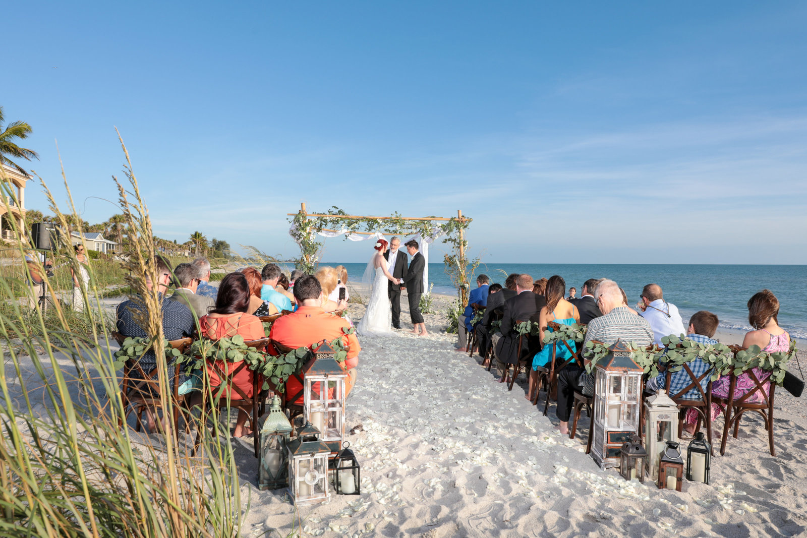 Siesta Key Wedding Photography, ceremony pictures with bride and groom under flower archway
