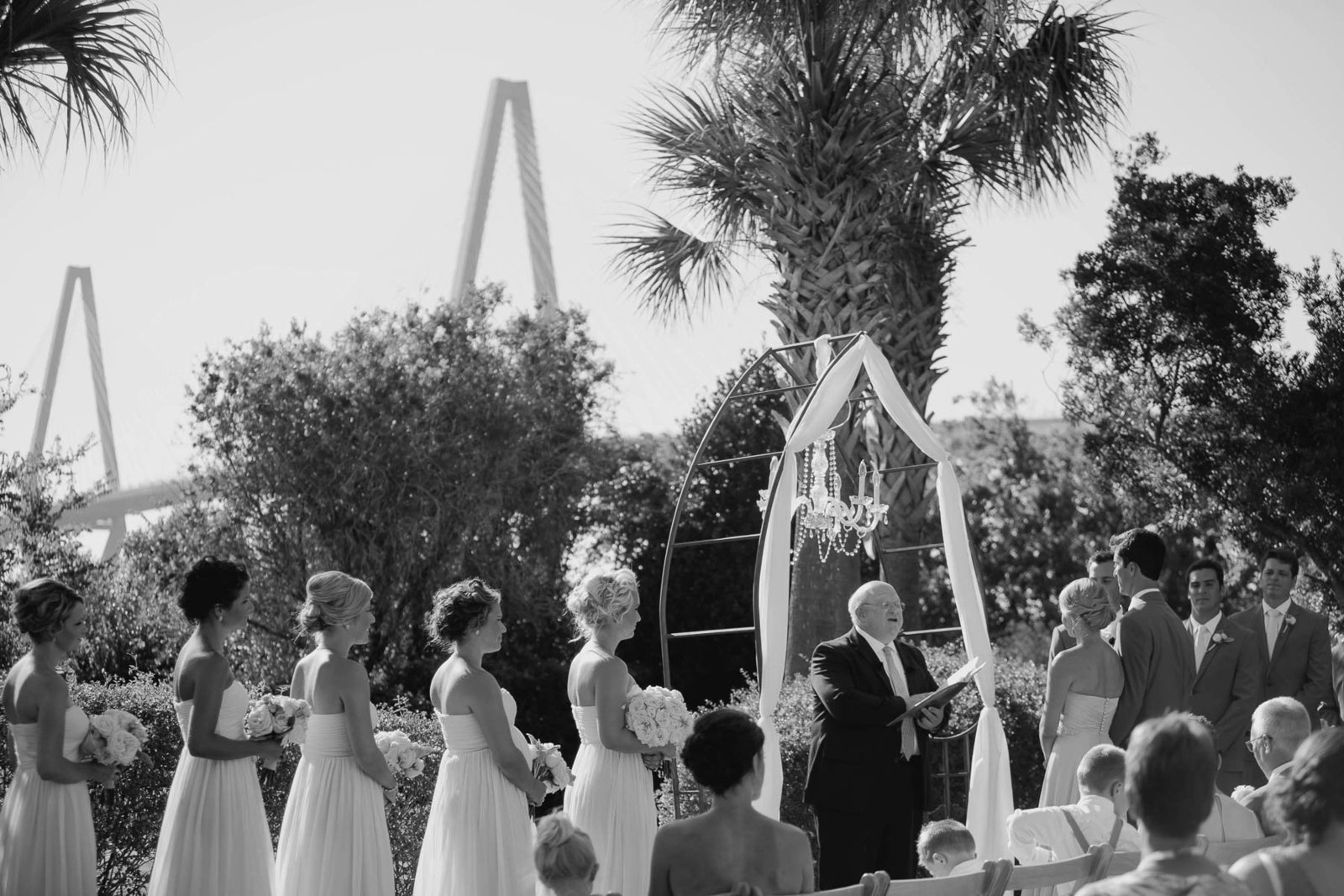 Bride and groom exchange vows with Ravenel Bridge in background, Harborside East, Mt Pleasant, South Carolina