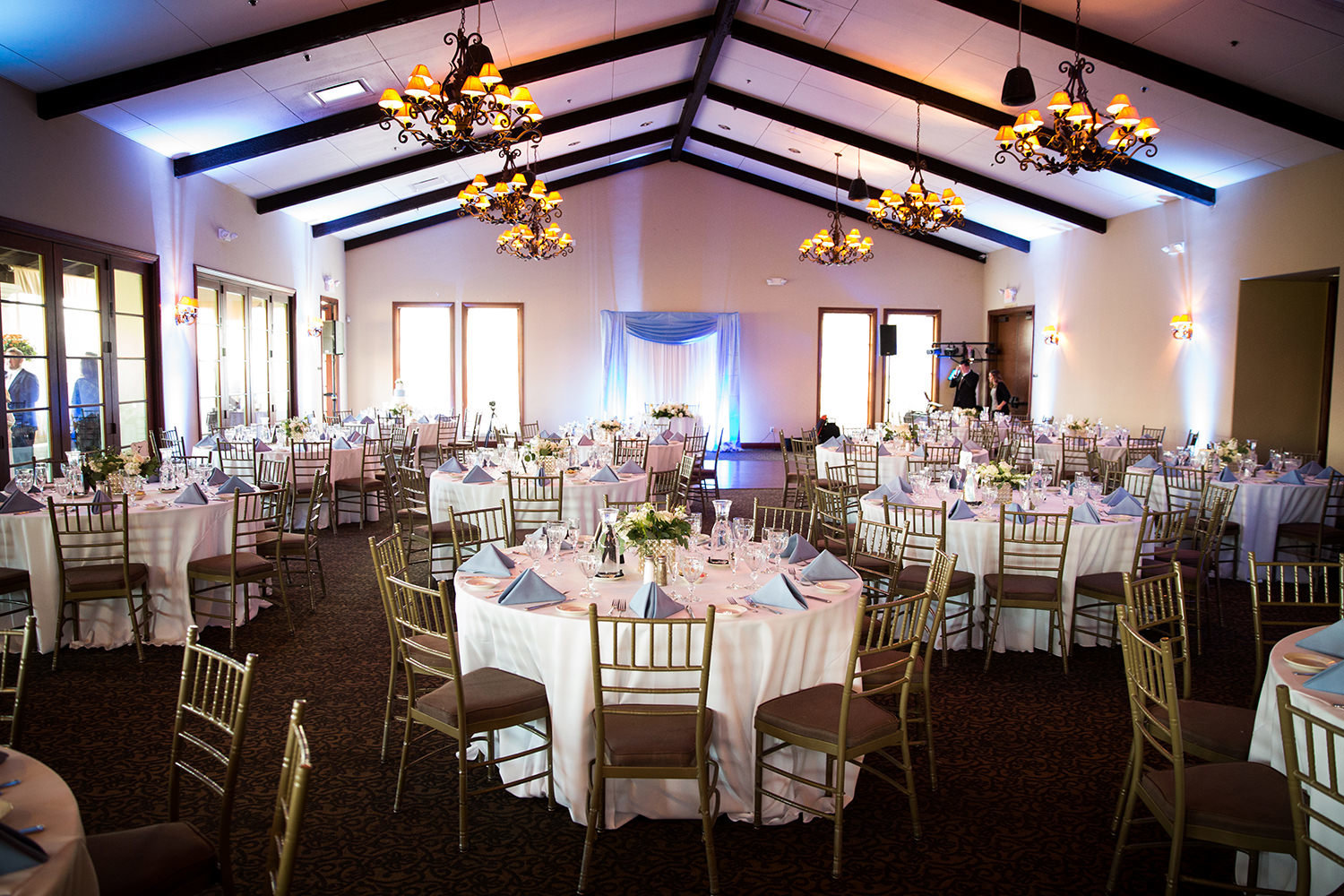 reception space at wedgewood purple blue uplighting