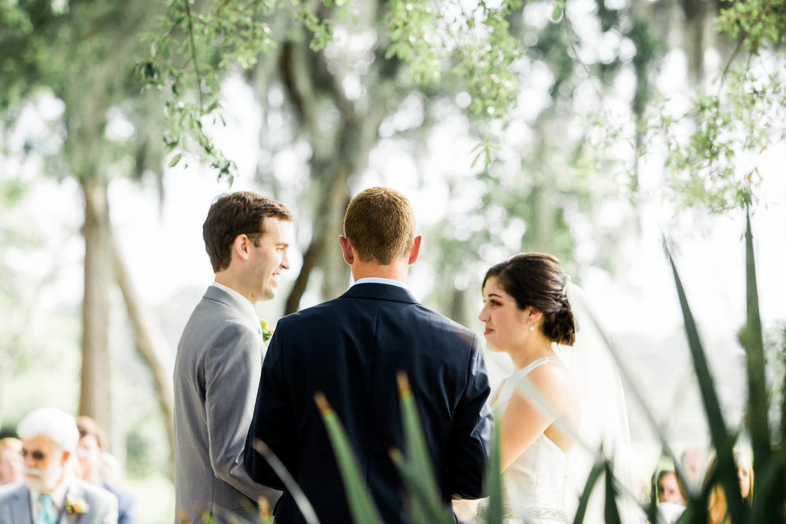 Bride and groom exchange vows, I'on Creek Club, Mt Pleasant, South Carolina. Kate Timbers Photography.