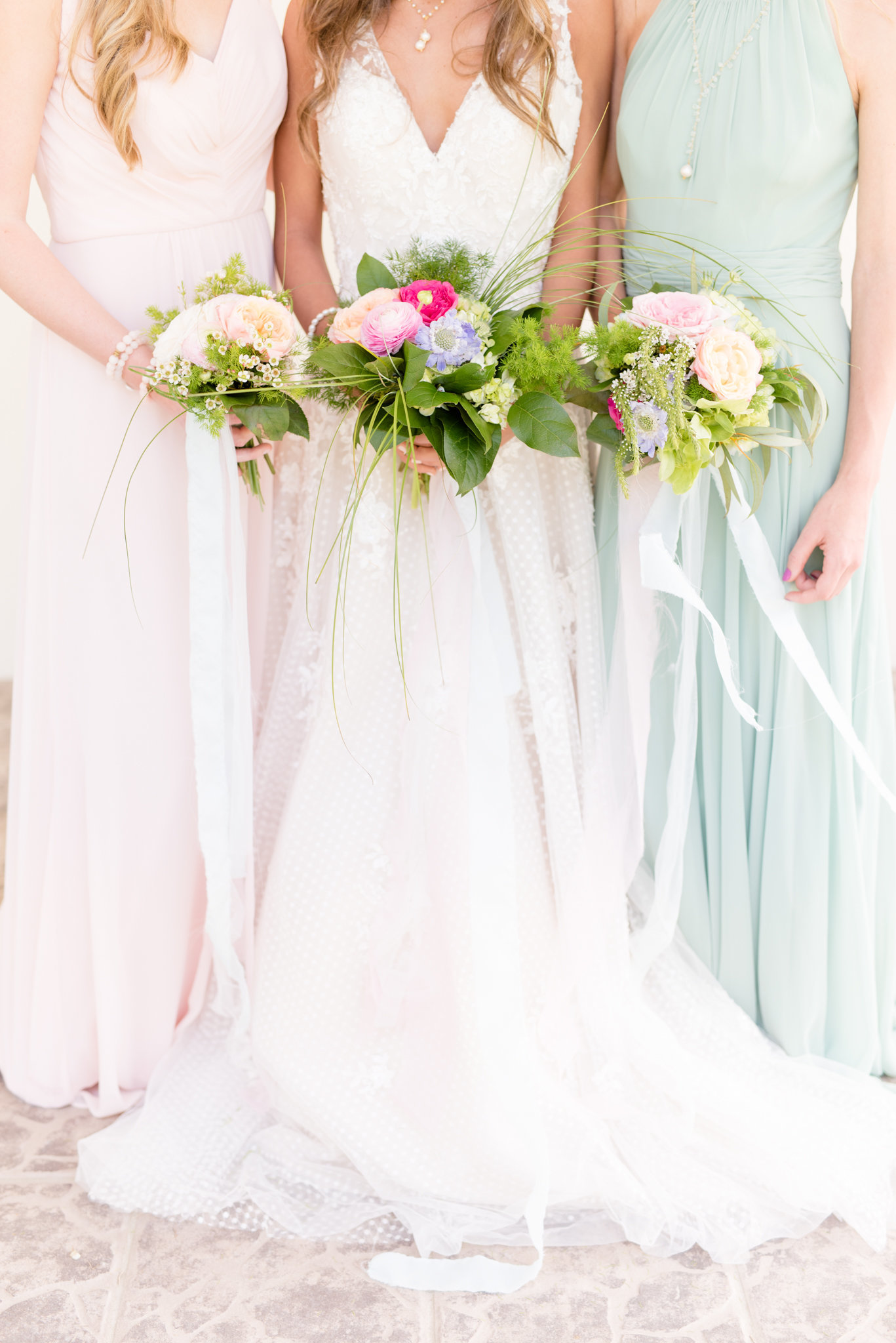 Tampa bride and bridesmaids hold bouquets.