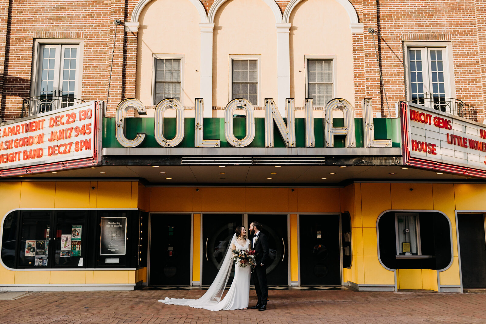 bride and groom at historic colonial theatre