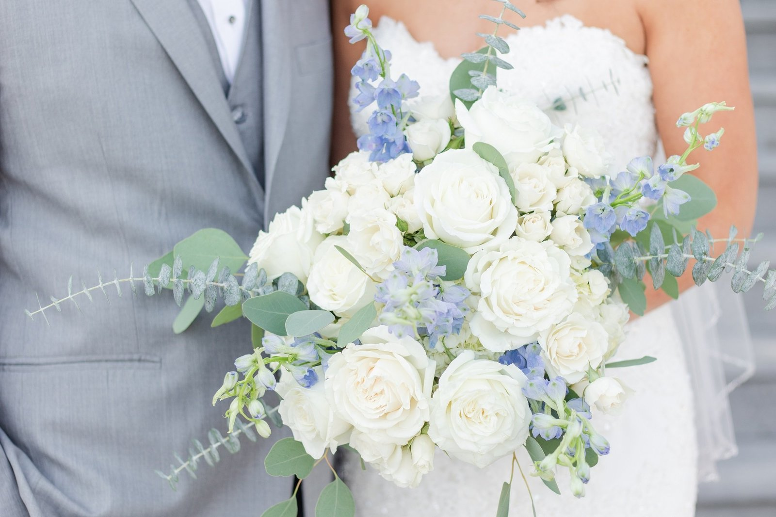 Val and Ryan holding blue and white bouquet