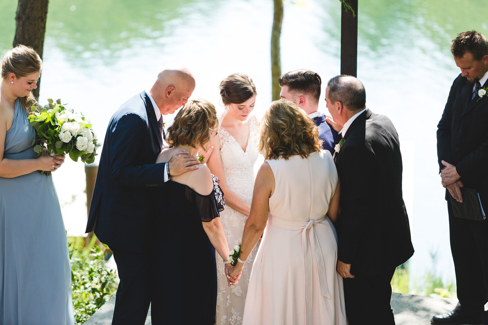 bride and groom being prayed for during ceremony by family micro wedding ohio