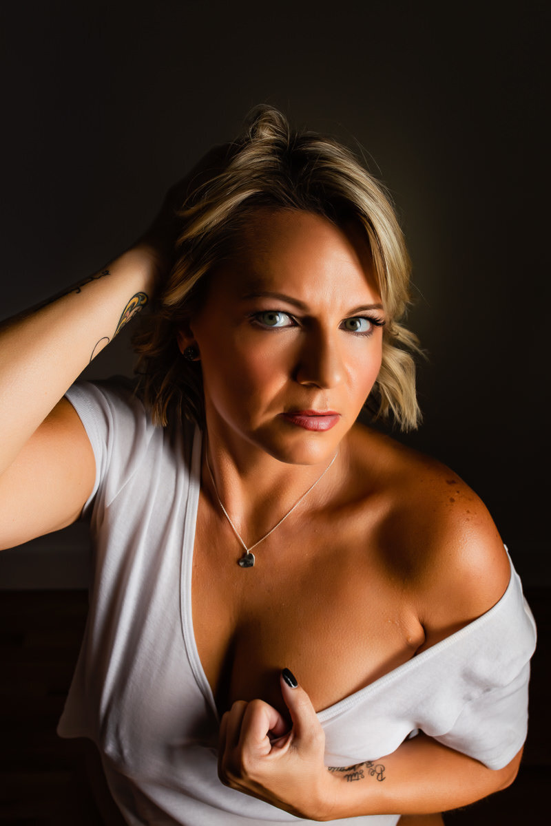Boudoir photo of a woman in a wet t-shirt