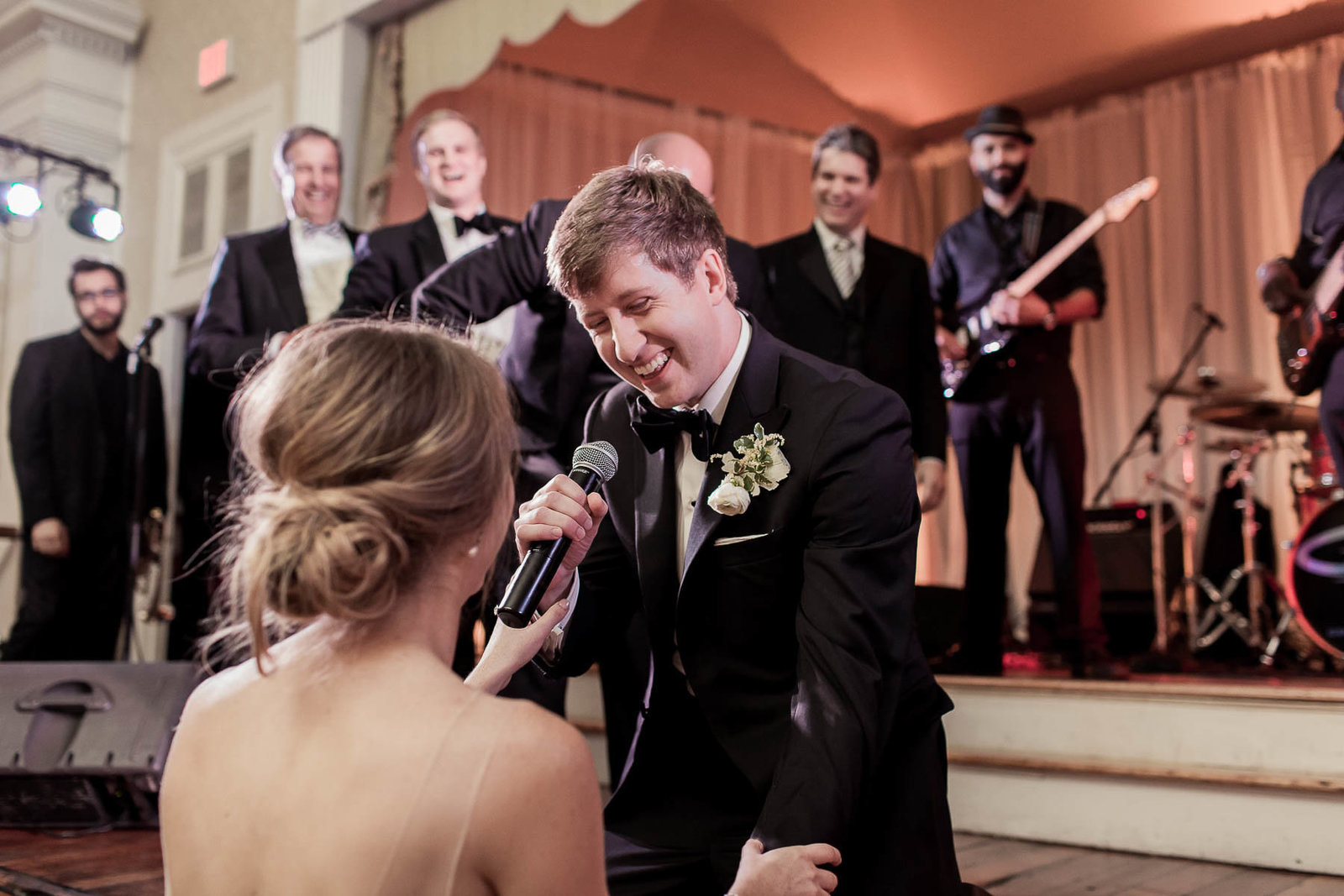 Groom gets pulled up on stage and sings to bride, Hibernian Hall, Charleston, South Carolina