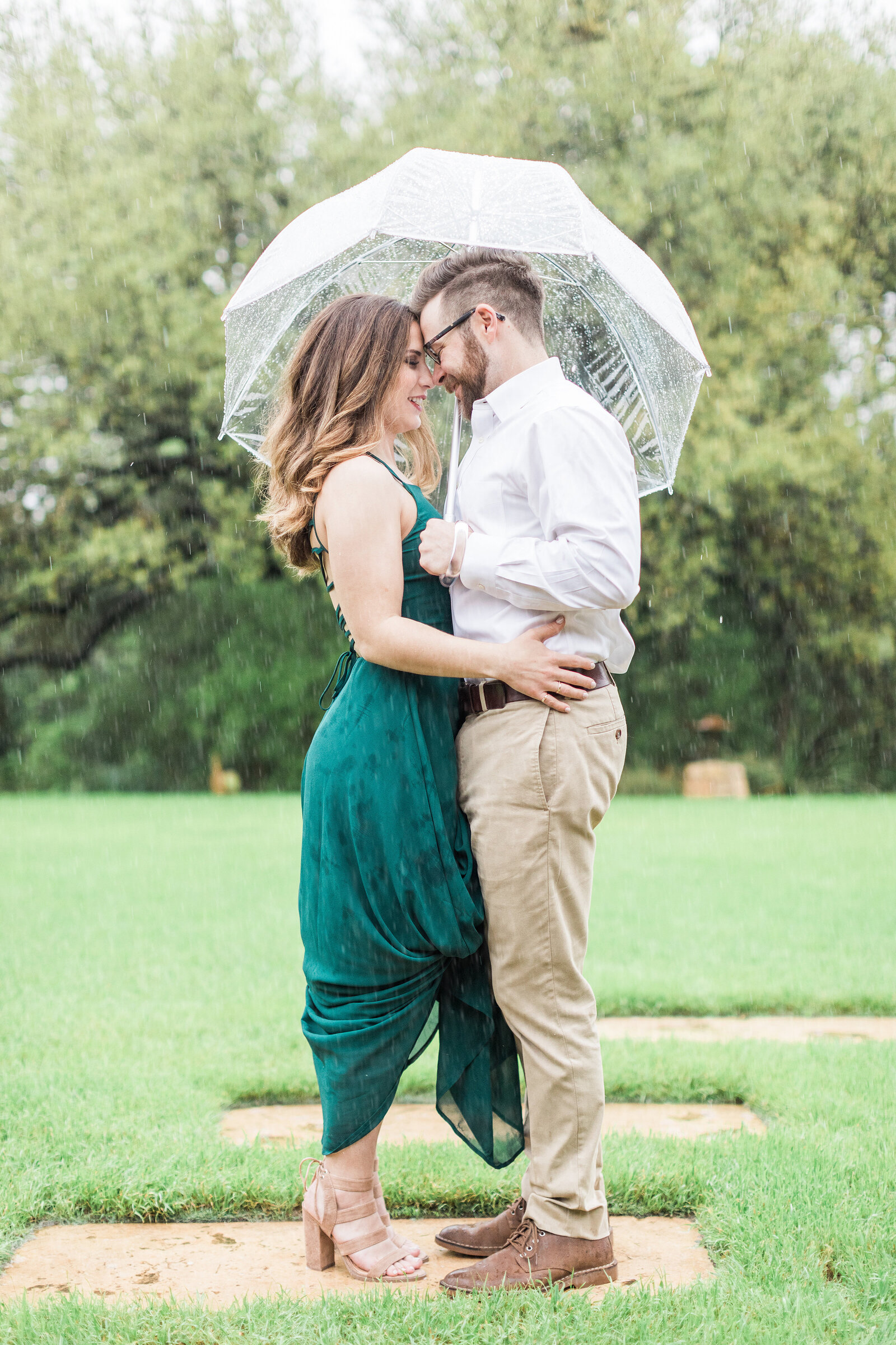 An Engaged Couple in the Rain at Camp Lucy