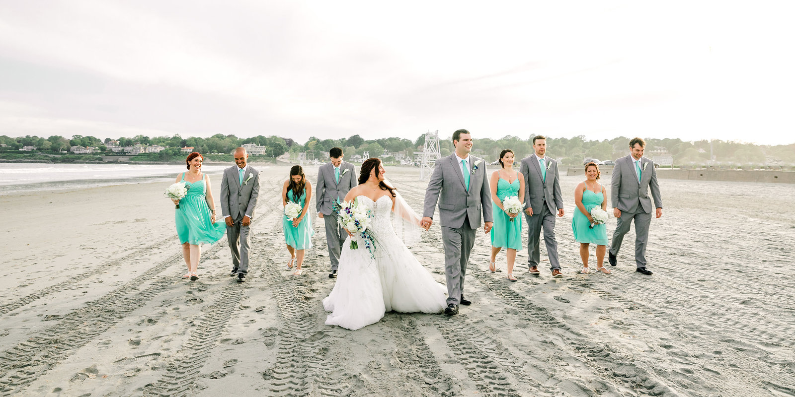 wedding party walk along Eastons Beach in Newport RI for Rotunda Ballroom wedding