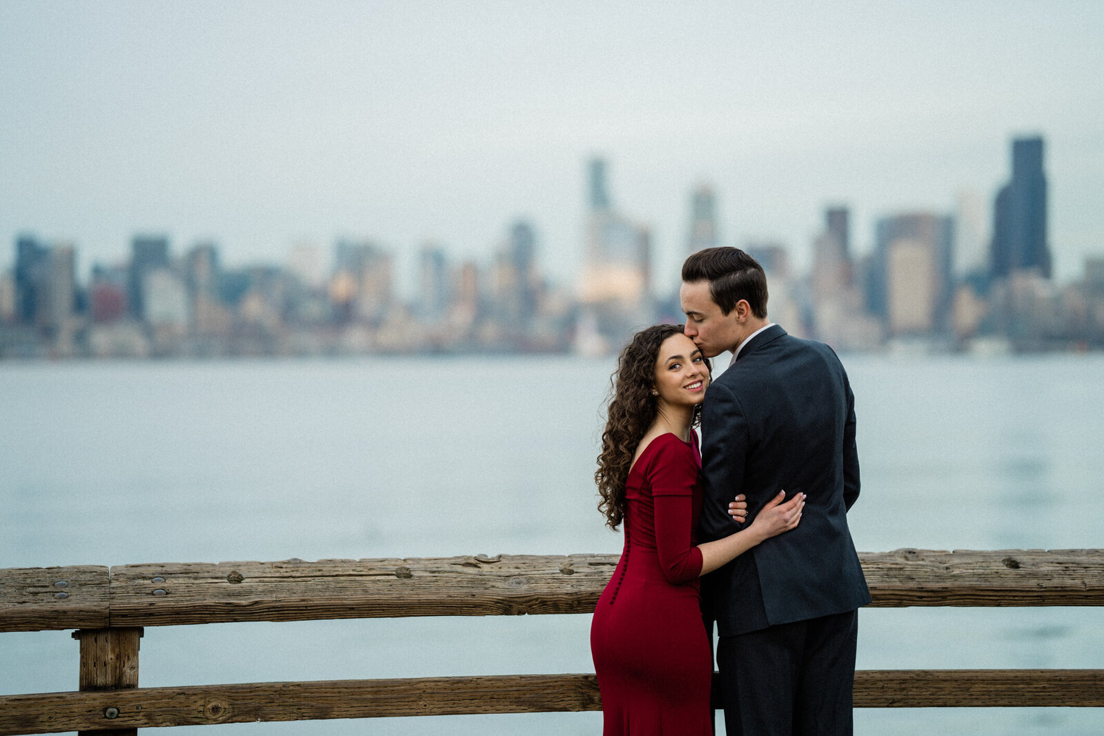 Puget Sound in the distance of the engagement pictures near Alki Beach, best places for engagement photos in Seattle