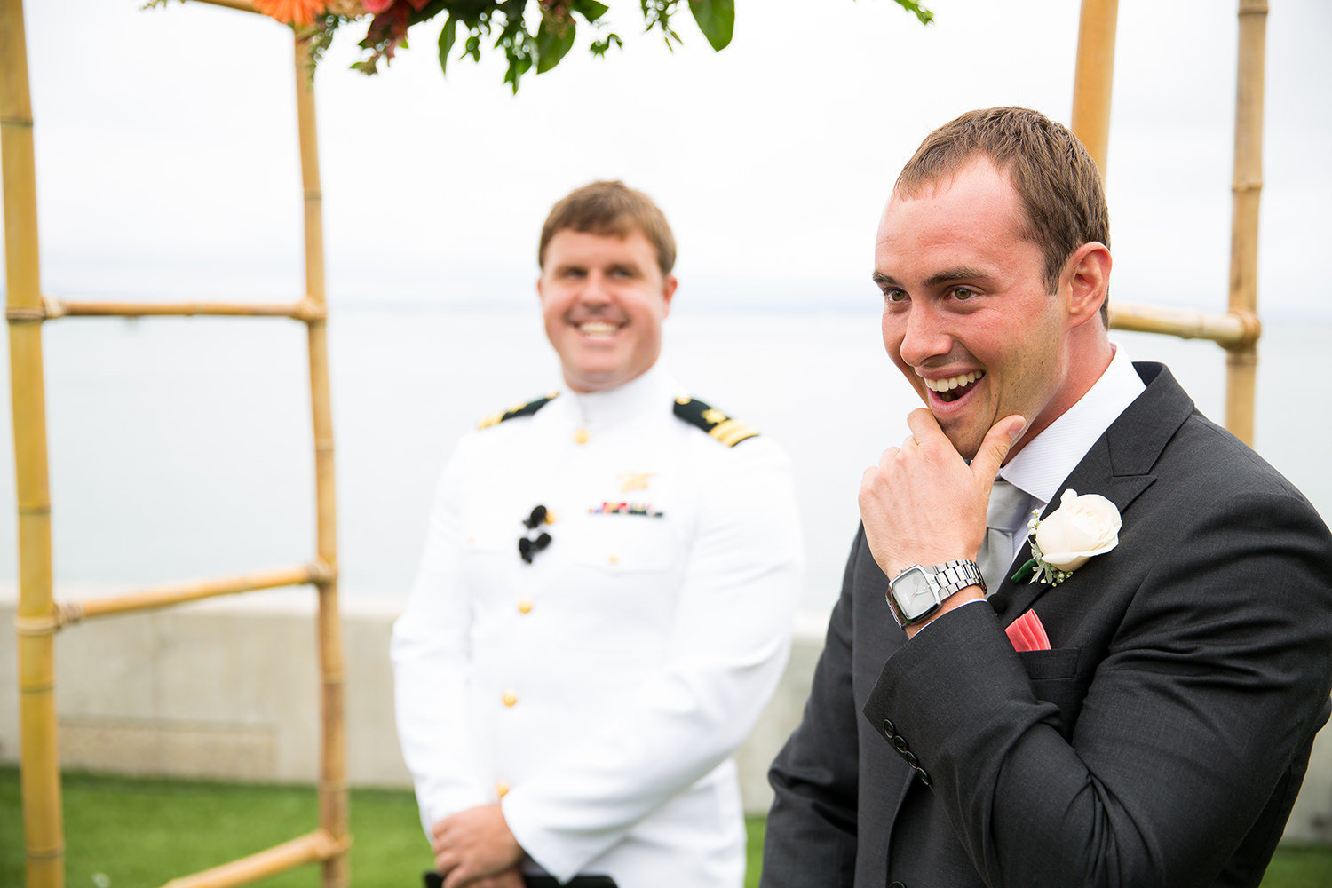groom seeing bride walk down the aisle at ocean view room