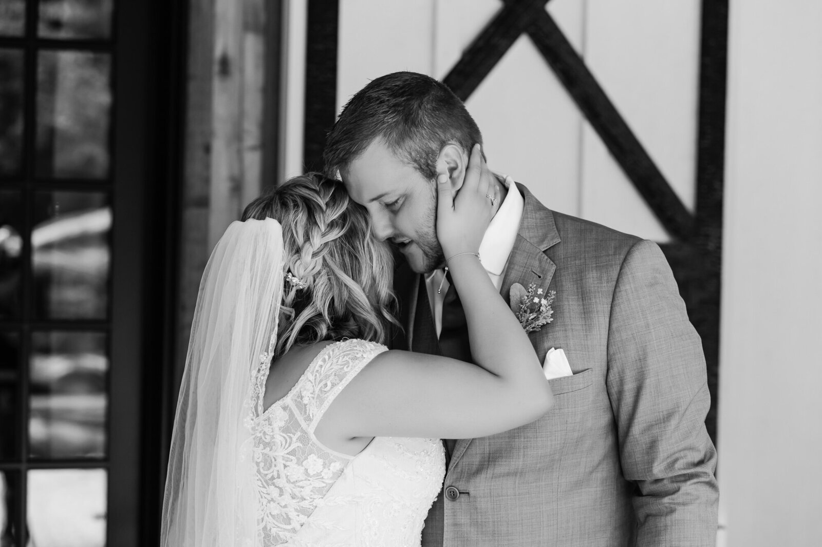 Emotional, candid photo of a first look between a bride and her groom before their wedding
