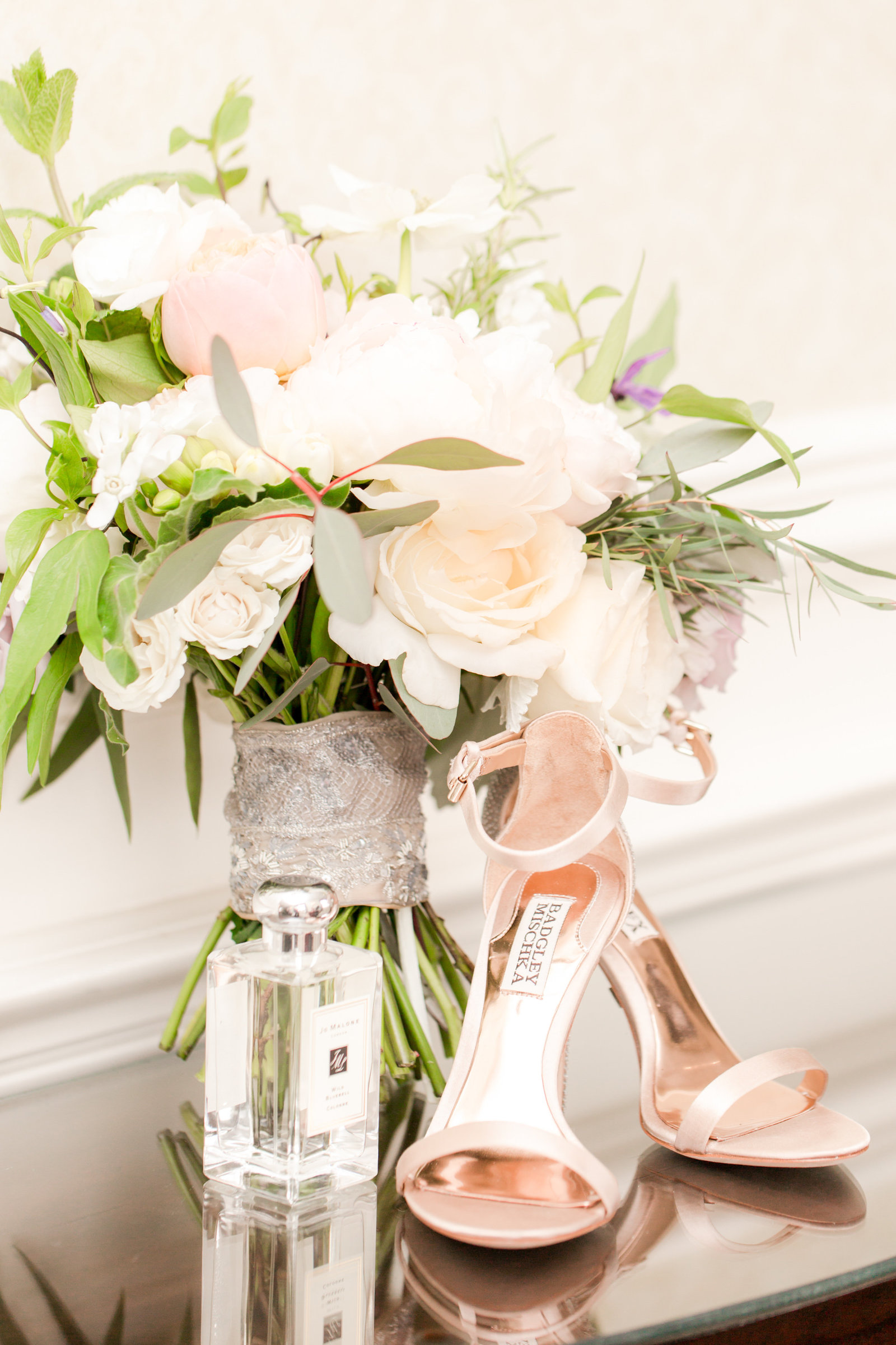 Wedding shoes, perfume, and bouquet