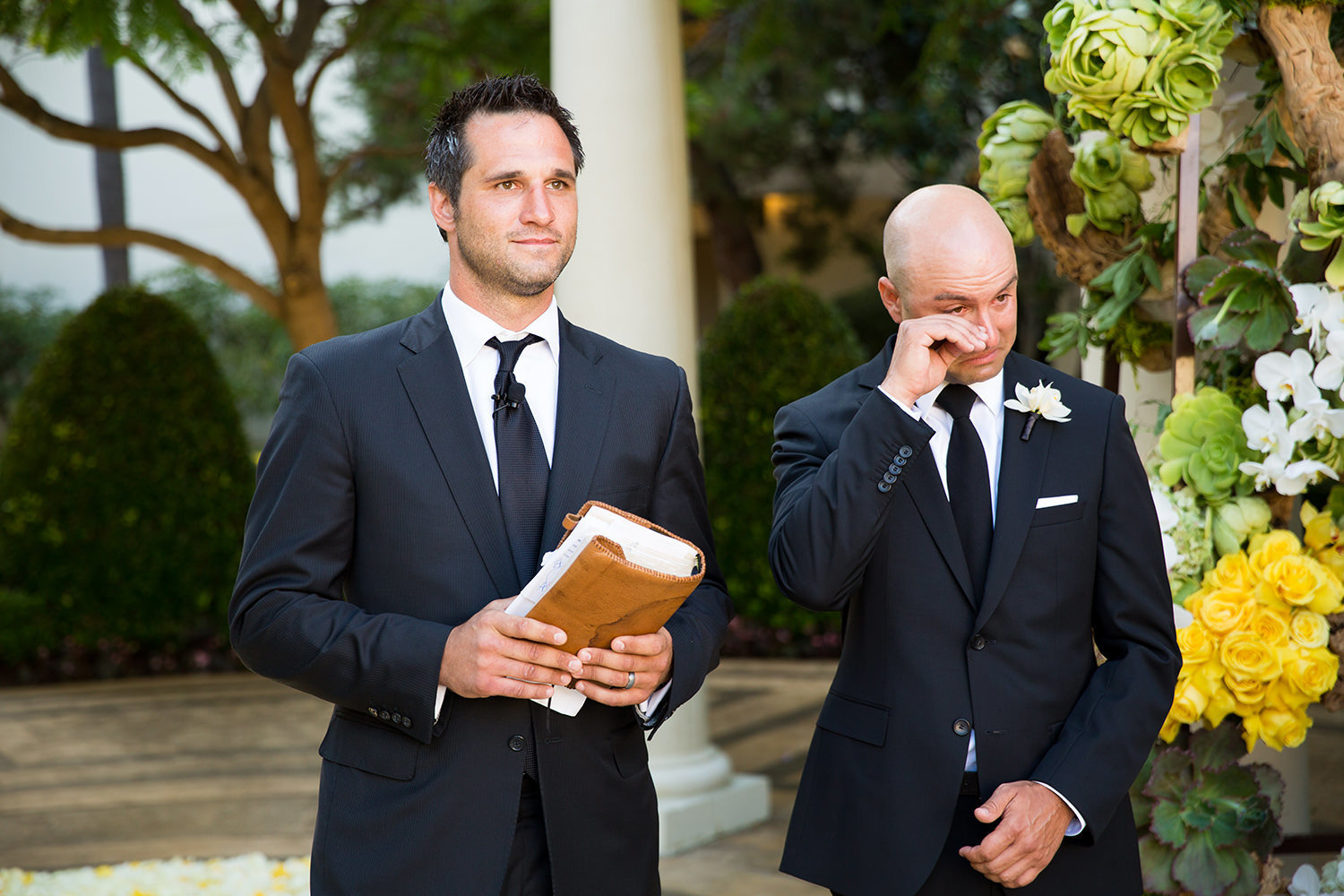 The groom's emotions begin to show when he sees his bride for the first time