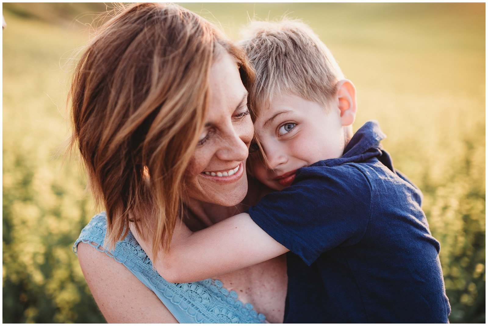 little boy hugging mom in field at sunset Emily Ann Photography Seattle Family Photographer