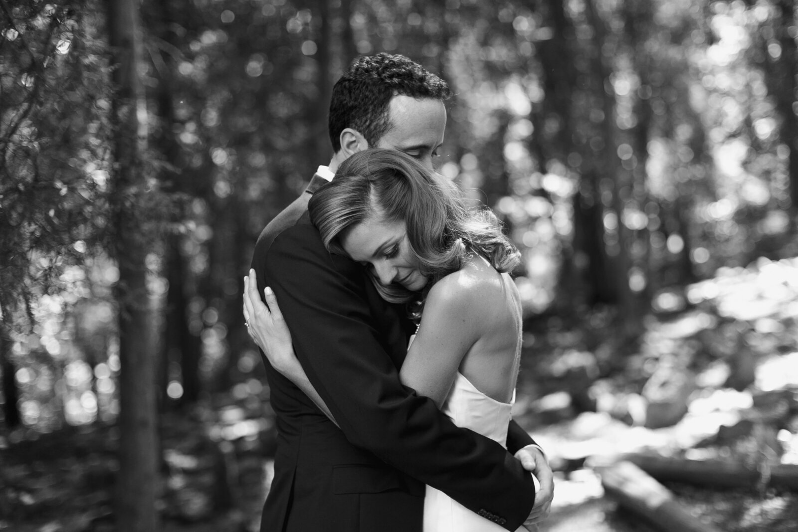 black and white couple hugging in forrest