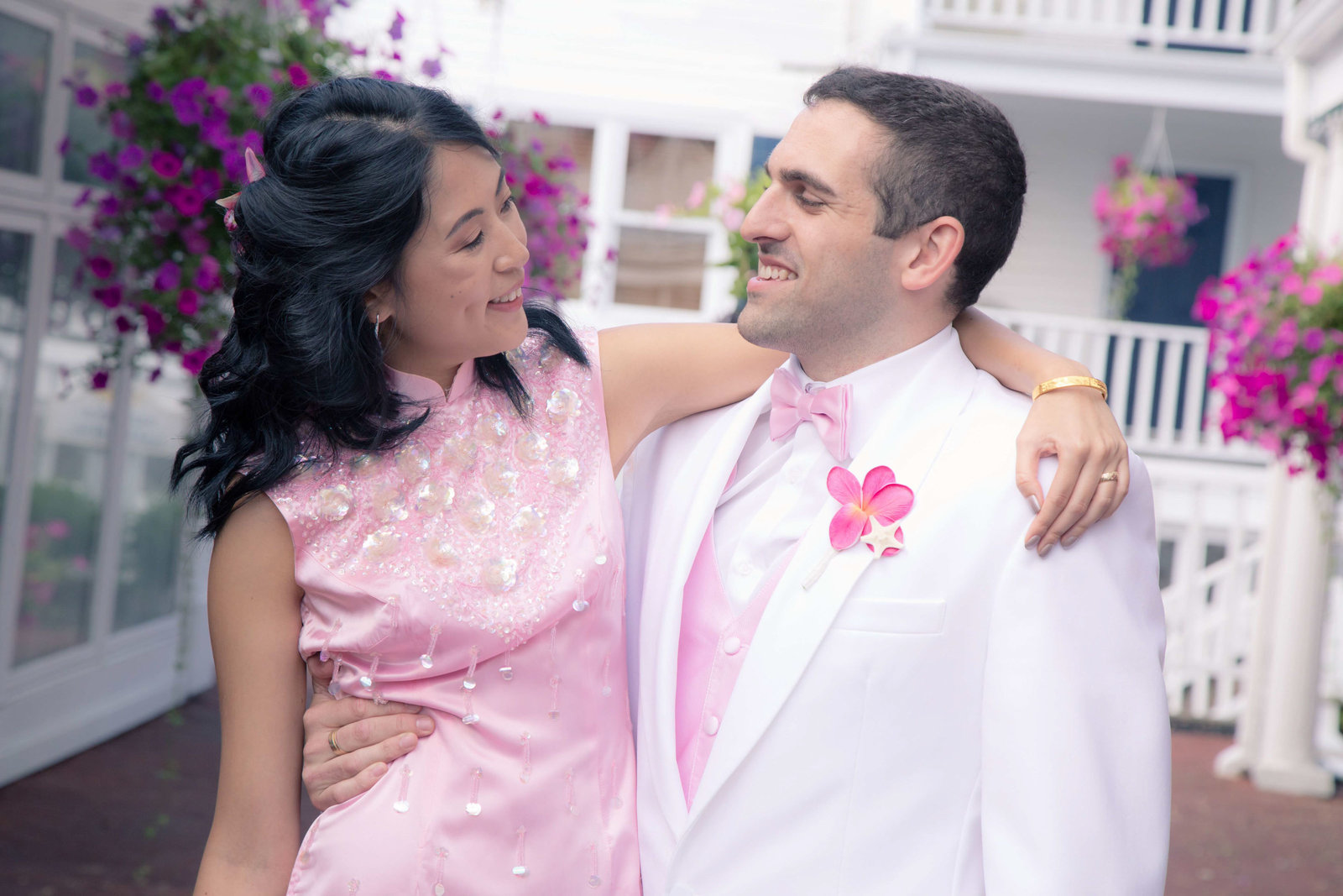 Bride wraps her hand around grooms back and they smile in Port Jefferson.
