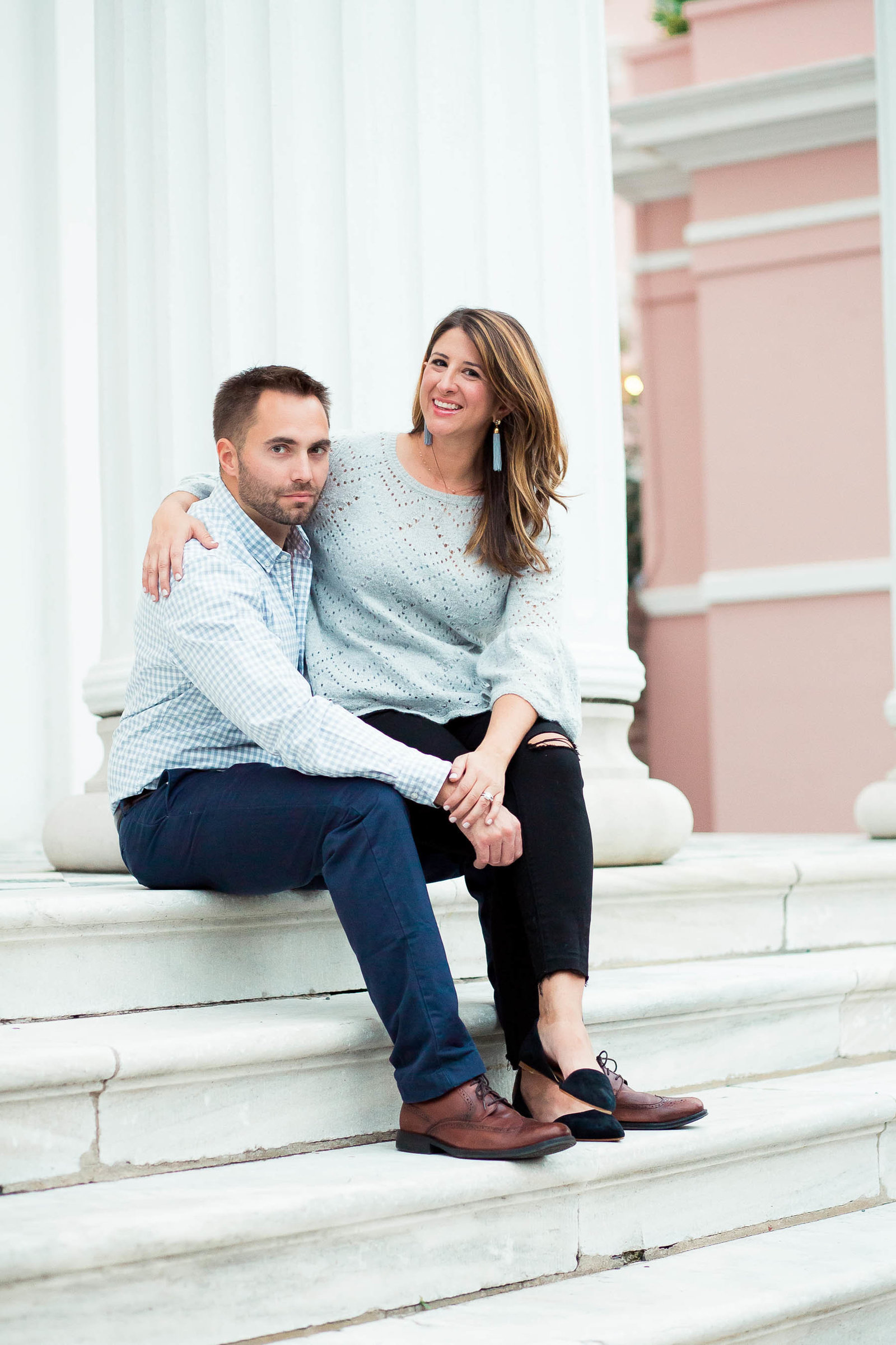 Couple sits on steps of Hibernian Hall for Engagement
