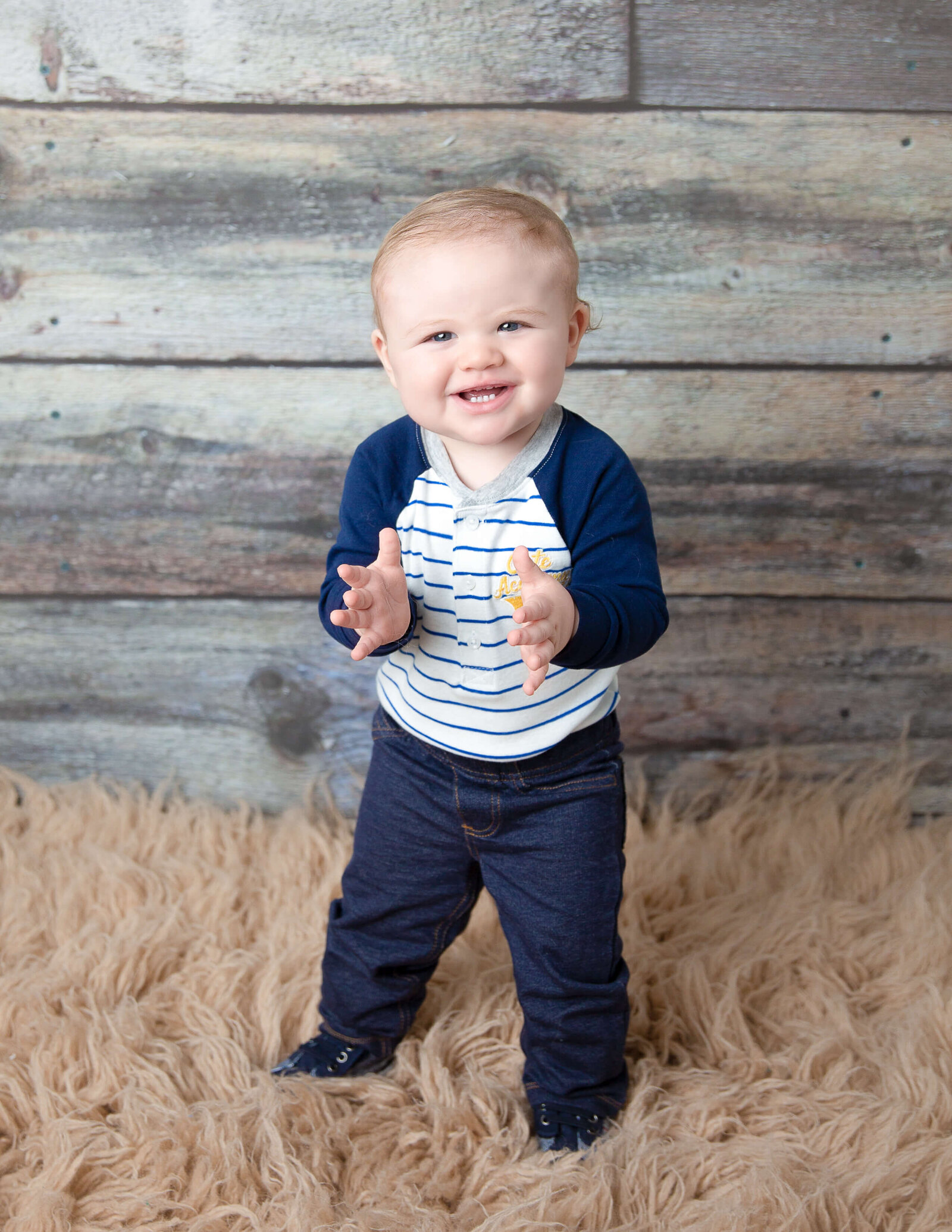 Cute boy posed at our Rochester, Ny studio.