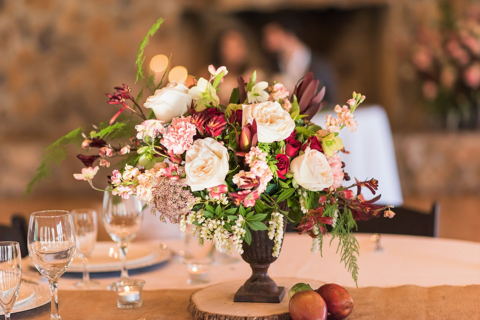 burgundy and blush reception centerpiece in the barn at Seneca Creek Park