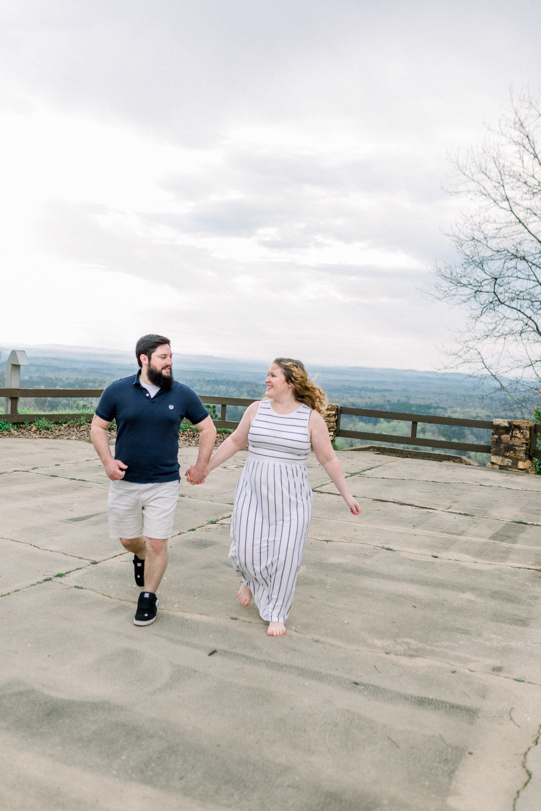Couple running and laughing captured by Staci Addison Photography