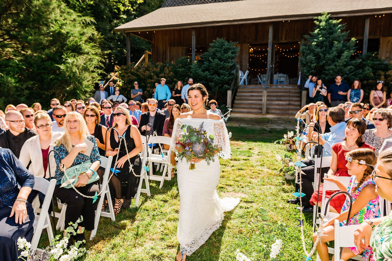 Bride walking down aisle for winery wedding cemony at Chaumette Vineyards