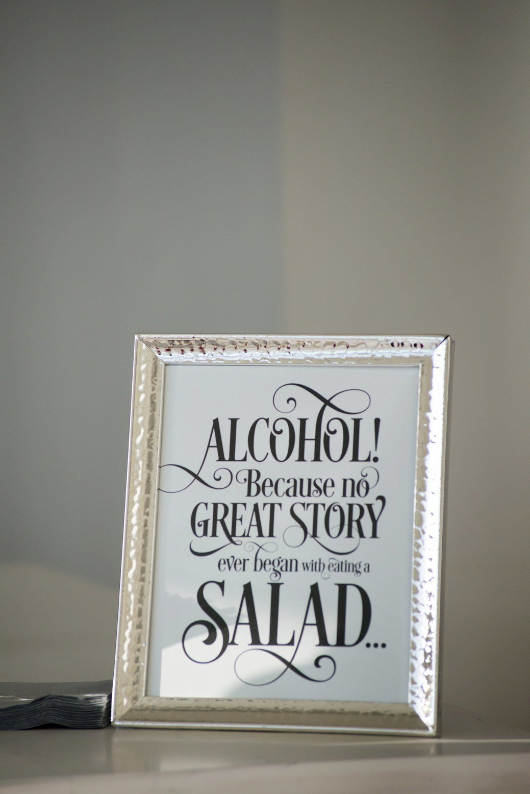 Alcohol! Because no great story ever began with a salad sign for wedding