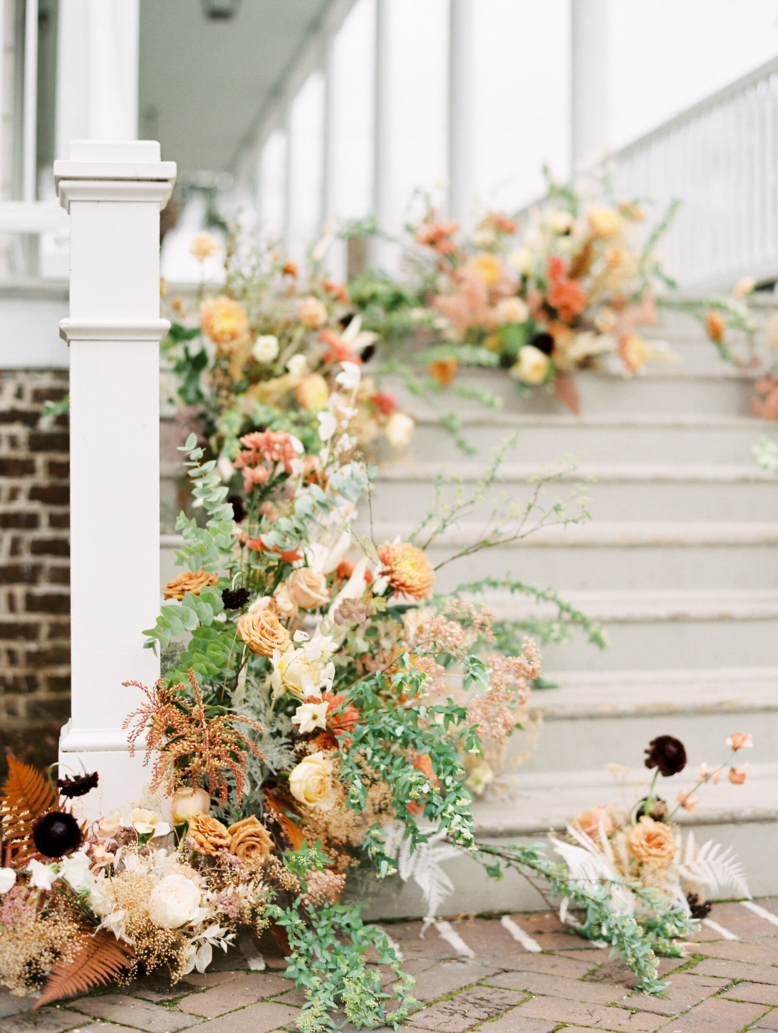 floral arrangement outside on the steps at the gadsden house in charleston south carolina