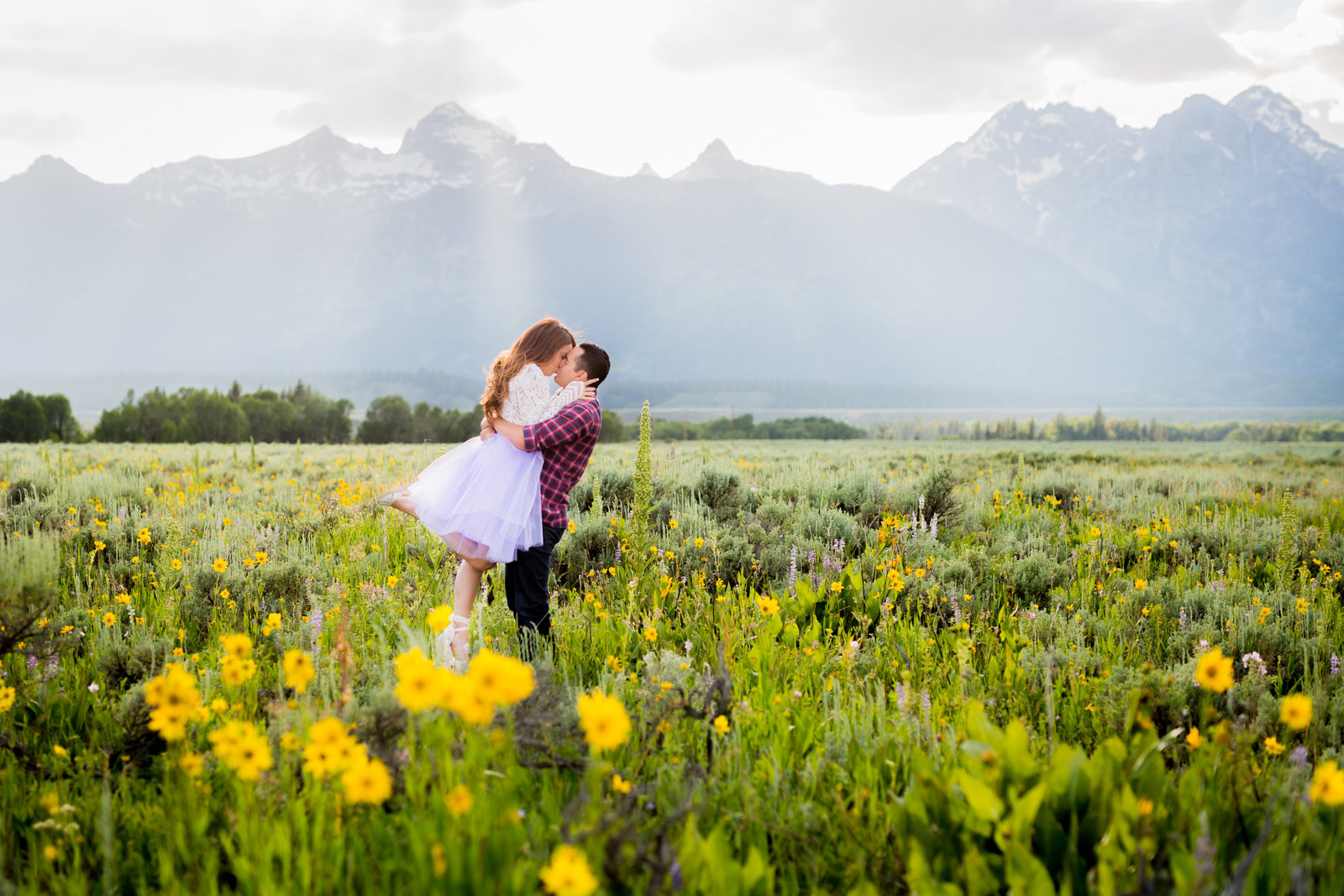 Engagement session in wildflowers Jackson Hole WY
