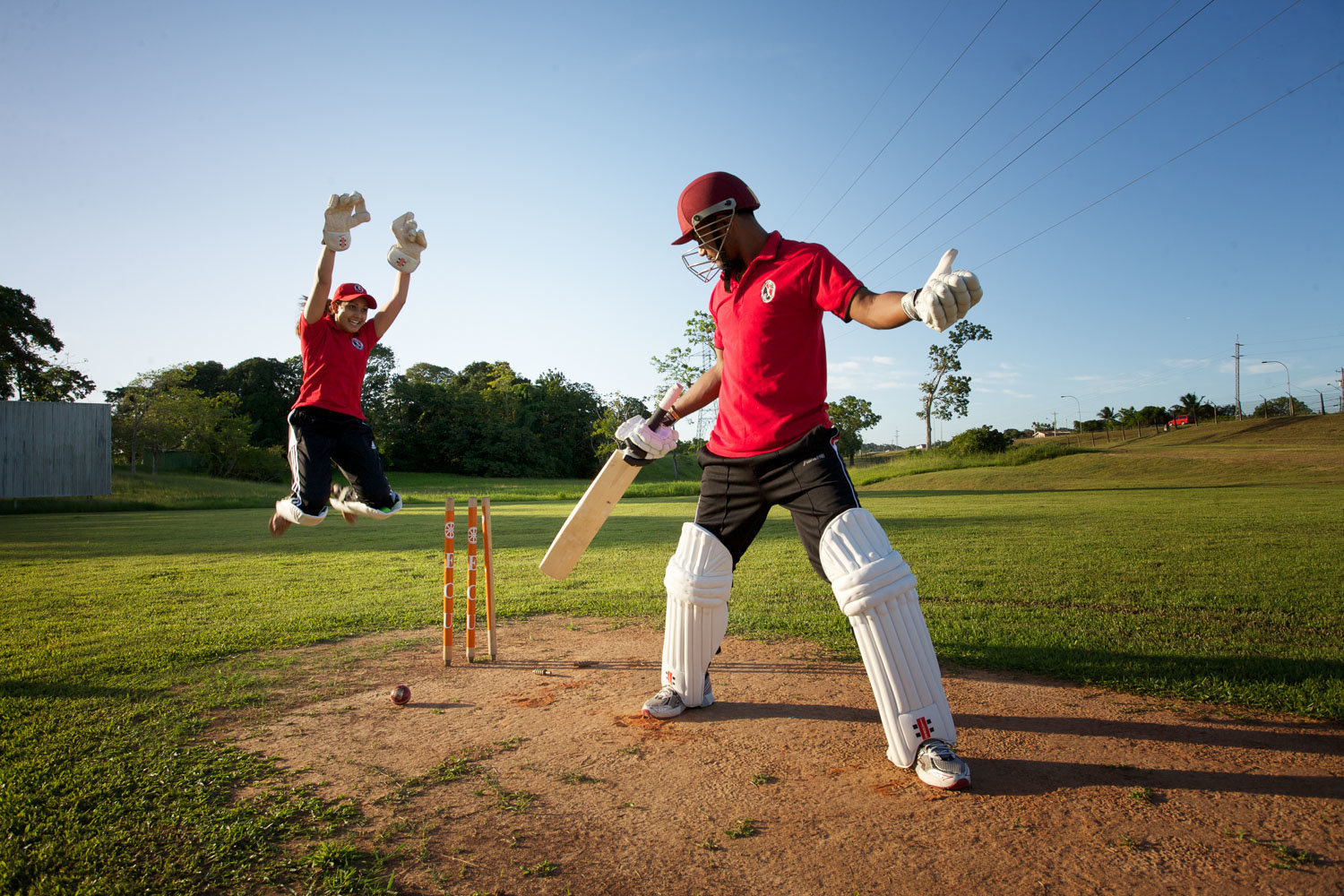 Engaged couple playing cricket. Photo by Ross Photography, Trinidad, W.I..
