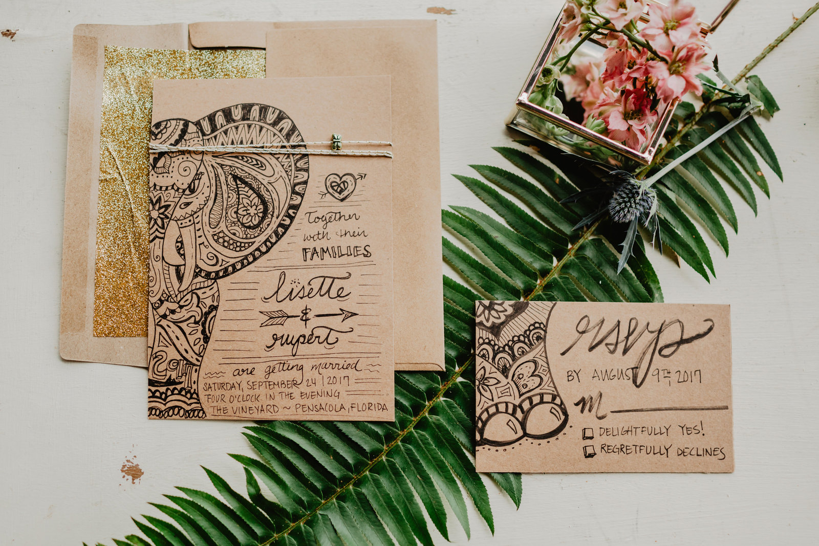 Wedding invitation suite with elephant boho accents.