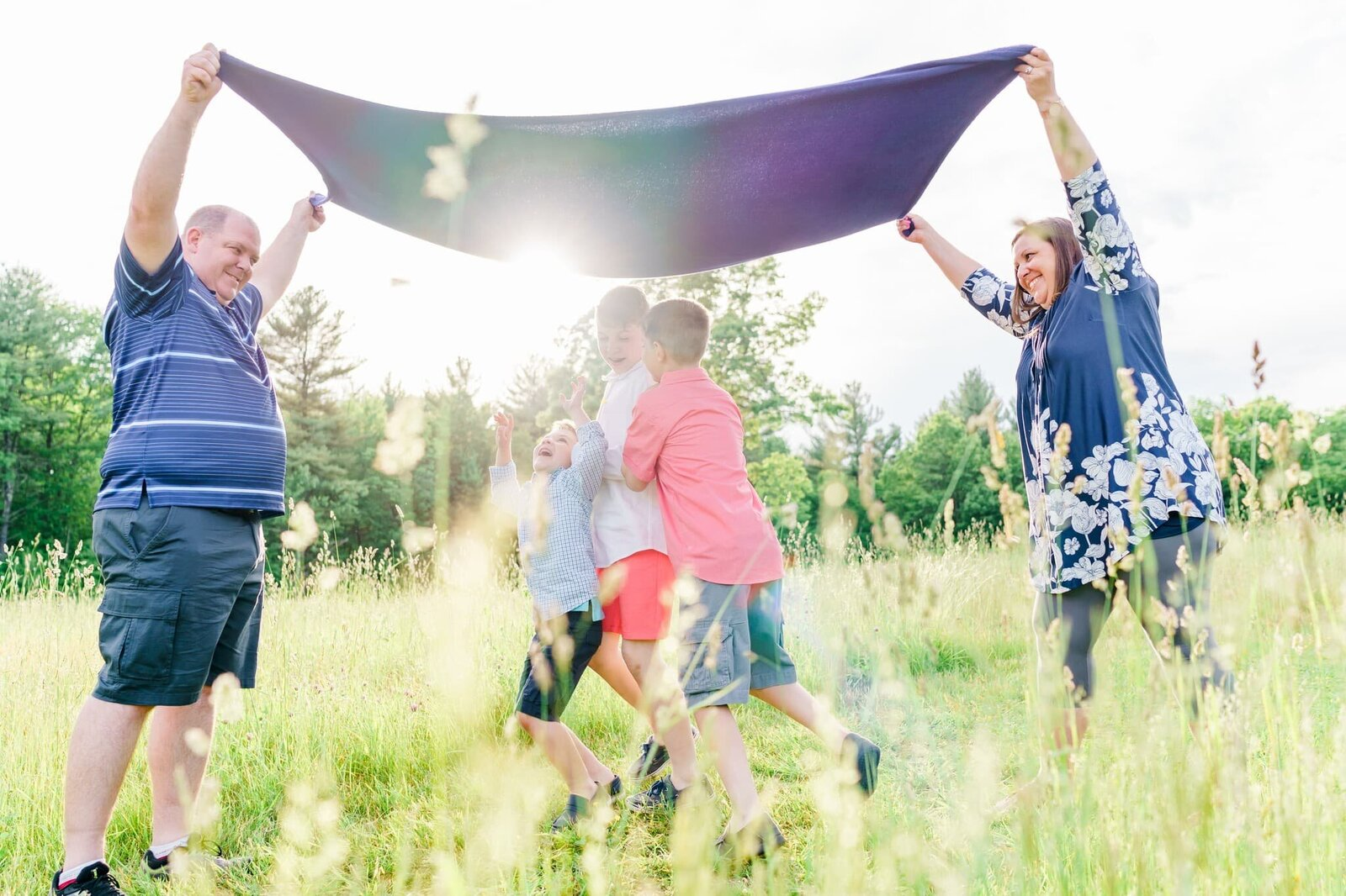 Blanket up in the air for family photos