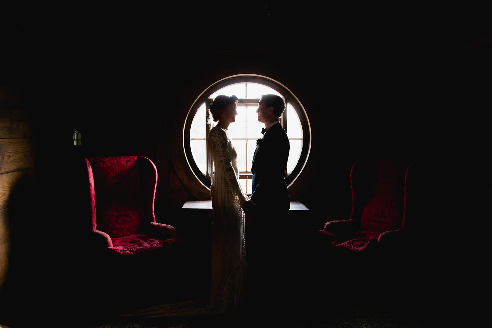 bride and groom silhouetted in window