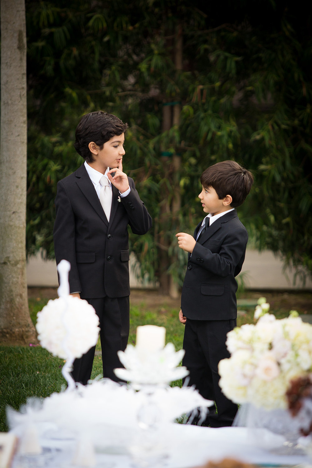 Ring bearers distracted during the wedding ceremony