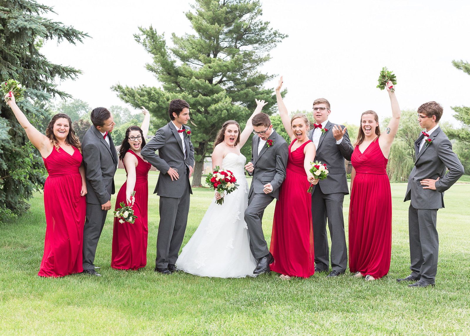 Indianapolis  Valle Vista wedding  bridal party  cheering red and charcoal photo by Simply Seeking Photography
